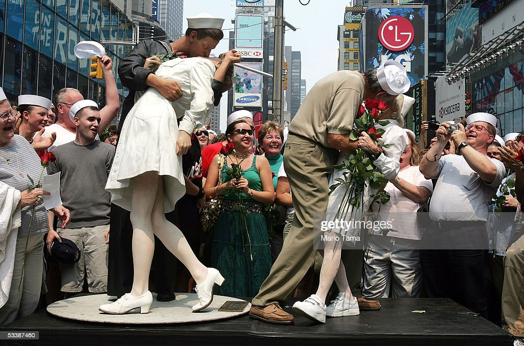 Carl Muscarello and Edith Shain, who claim to be the nurse and sailor in the famous photograph taken on V-J Day, kiss next to a sculpture based on the photograph in Times Square to commemorate the 60th anniversary of the end of World War II August 14, 2005 in New York City. Alfred Eisenstaedt took the famous photograph in Times Square but did not note the names of the people in the picture.