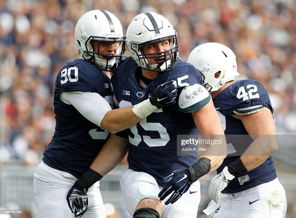 Carl Nassib #95 of the Penn State Nittany Lions celebrates with Garrett Sickels #90 after a sack in the second half during the game against the Illinois Fighting Illini on October 31, 2015 at Beaver Stadium in State College, Pennsylvania.