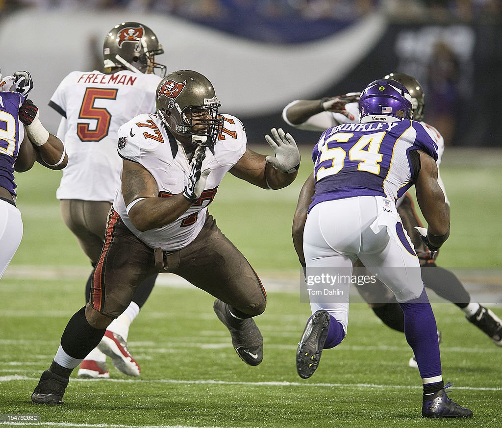 Carl Nicks #77 of the Tampa Bay Buccaneers blocks during an NFL game against the Minnesota Vikings at Mall of America Field at the Hubert H. Humphrey Metrodome on October 25, 2012 in Minneapolis, Minnesota.