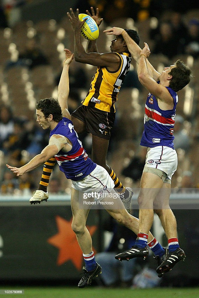 Carl Peterson of the Hawks flies for a mark during the round 14 AFL match between the Hawthorn Hawks and the Western Bulldogs at Melbourne Cricket...