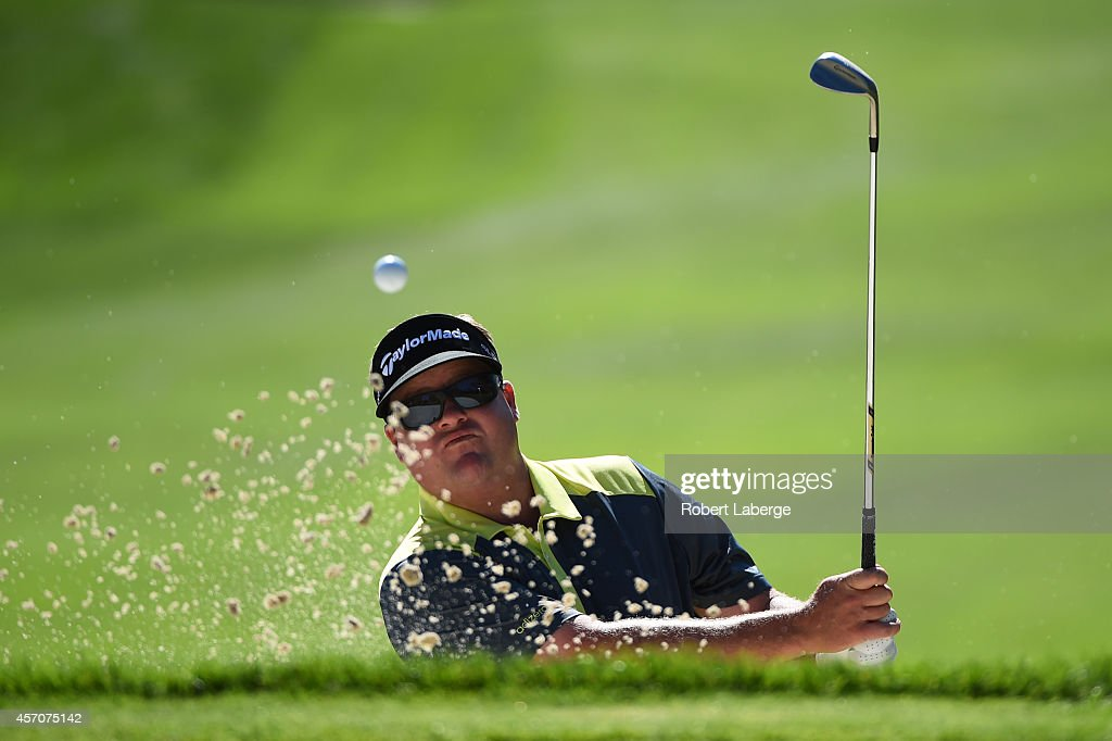 Carl Petterson hits out of the bunker on the fourth hole during round three of the Fryscom Open at Silverado Resort and Spa on October 11 2014 in...