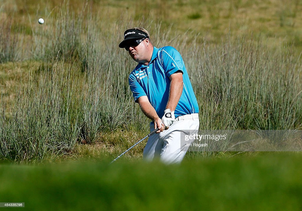 Carl Pettersson chips onto the fourth green during the first round of the Deutsche Bank Championship at the TPC Boston on August 29 2014 in Norton...