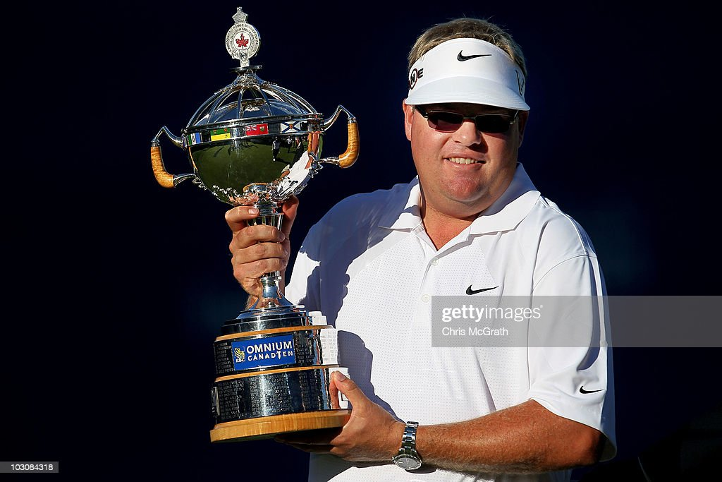 Carl Pettersson holds aloft the trophy after winning the 2010 RBC Canadian Open at St George's Golf and Country Club on July 25 2010 in Etobicoke...