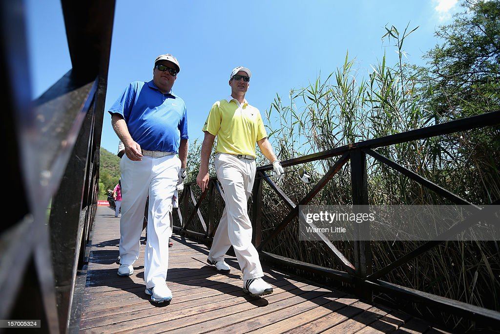 Carl Pettersson of Sweden and Garth Mulroy of South Africa cross a bridge during a practice round ahead of the Nedbank Golf Challenge at the Gary Player Country Club on November 27, 2012 in Sun City, South Africa.
