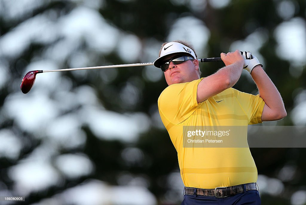 Carl Pettersson of Sweden hits a tee shot on the third hole during the final round of the Hyundai Tournament of Champions at the Plantation Course on January 8, 2013 in Kapalua, Hawaii.