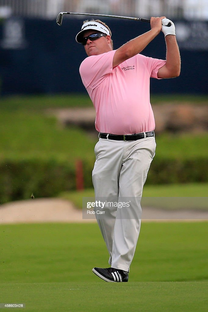 Carl Pettersson of Sweden hits his second shot to the 16th green during the first round of the OHL Classic at Mayakoba on November 13 2014 in Playa...