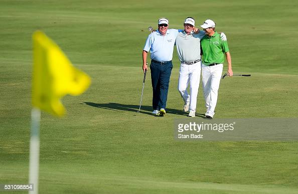 Carl Pettersson of Sweden Jason Bohn and George McNeill smile as they walk up the 18th hole during the first round of THE PLAYERS Championship on THE...