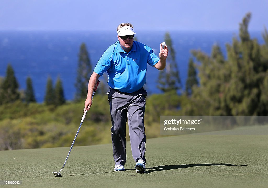 Carl Pettersson of Sweden reacts to the fans on the ninth hole green following the replay of the first round of the Hyundai Tournament of Champions at the Plantation Course on January 7, 2013 in Kapalua, Hawaii.