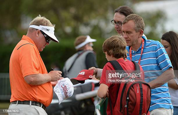 Carl Pettersson of Sweden signs autographs ahead of the 142nd Open Championship at Muirfield on July 16 2013 in Gullane Scotland