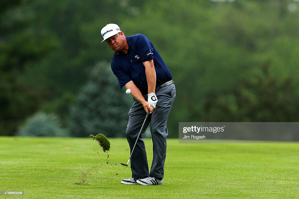 Carl Pettersson plays a shot on the second hole during the final round of the Travelers Championship at TPC River Highlands on June 28 2015 in...
