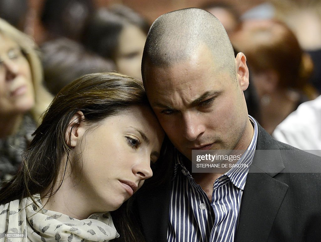 Carl Pistorius (R) and Aimee Pistorius (L) attend the appearance of their brother South African Olympic sprinter Oscar Pistorius on February 19, 2013 at the Magistrate Court in Pretoria. Pistorius battled to secure bail as he appeared on charges of murdering his model girlfriend Reeva Steenkamp on February 14, Valentine's Day. South African prosecutors will argue that Pistorius is guilty of premeditated murder in Steenkamp's death, a charge which could carry a life sentence.