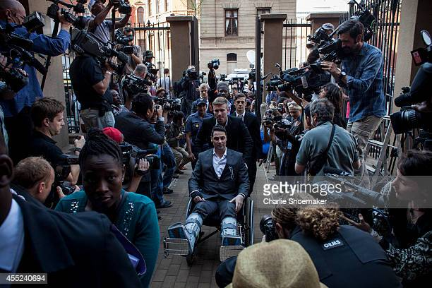 Carl Pistorius Oscar's brother arrives at the High Court on September 11 2014 in Pretoria South Africa South African Judge Thokosile Masipa is due to...
