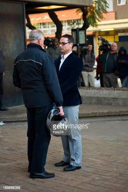 Carl Pistorius Oscar's brother chats to Ampie Louw Oscar's coach outside the Pretoria Magistrates court on June 4 in Pretoria South Africa Oscar...