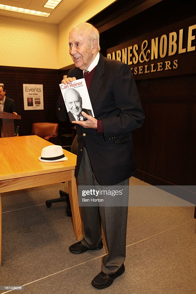 <a gi-track='captionPersonalityLinkClicked' href=/galleries/search?phrase=Carl+Reiner&family=editorial&specificpeople=660635 ng-click='$event.stopPropagation()'>Carl Reiner</a> signs copies of his book 'I Remember Me' at Barnes & Noble bookstore at The Grove on April 24, 2013 in Los Angeles, California.