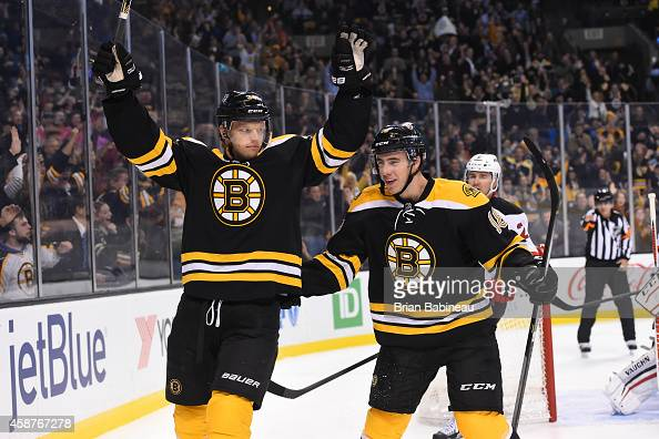 Carl Soderberg and Reilly Smith of the Boston Bruins celebrate a goal against the New Jersey Devils at the TD Garden on November 10 2014 in Boston...