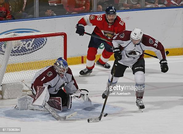Carl Soderberg clears the puck from in front of Goaltender Semyon Varlamov of the Colorado Avalanche as Jaromir Jagr of the Florida Panthers skates...
