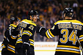 Carl Soderberg congratulates Loui Eriksson of the Boston Bruins after he scored a goal against the Florida Panthers during the first period at TD...
