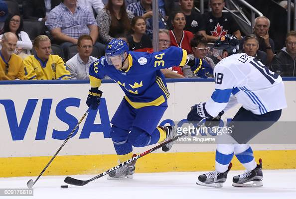 Carl Soderberg of Team Sweden controls the puck with pressure from Sami Lepisto of Team Finland during the World Cup of Hockey 2016 at Air Canada...