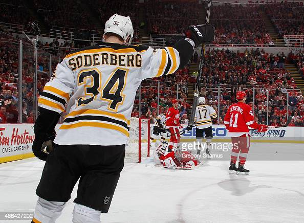 Carl Soderberg of the Boston Bruins celebrates his third period goal while playing the Detroit Red Wings at Joe Louis Arena on April 2 2015 in...