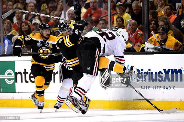 Carl Soderberg of the Boston Bruins checks Michal Rozsival of the Chicago Blackhawks in Game Six of the 2013 NHL Stanley Cup Final at TD Garden on...