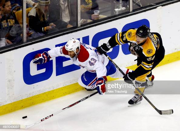 Carl Soderberg of the Boston Bruins checks Mike Weaver of the Montreal Canadiens during Game Seven of the Second Round of the 2014 NHL Stanley Cup...