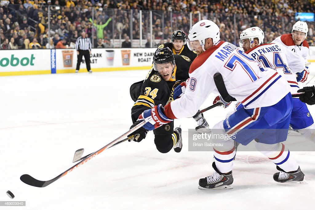 Carl Soderberg #34 of the Boston Bruins fights for the puck against <a gi-track='captionPersonalityLinkClicked' href=/galleries/search?phrase=Andrei+Markov&family=editorial&specificpeople=204528 ng-click='$event.stopPropagation()'>Andrei Markov</a> #79 of the Montreal Canadiens at the TD Garden on February 8, 2015 in Boston, Massachusetts.