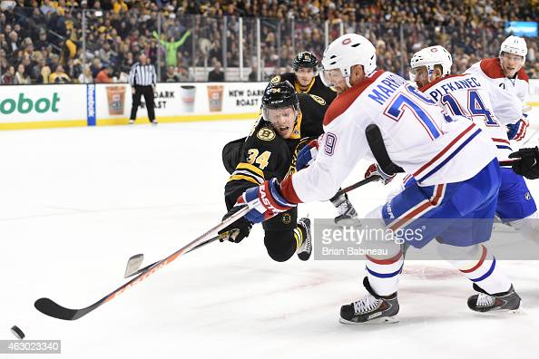 Carl Soderberg of the Boston Bruins fights for the puck against Andrei Markov of the Montreal Canadiens at the TD Garden on February 8 2015 in Boston...