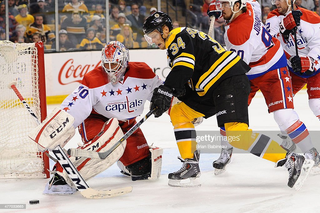 Carl Soderberg #34 of the Boston Bruins fights for the puck against <a gi-track='captionPersonalityLinkClicked' href=/galleries/search?phrase=Braden+Holtby&family=editorial&specificpeople=5370964 ng-click='$event.stopPropagation()'>Braden Holtby</a> #70 of the Washington Capitals at the TD Garden on March 6, 2014 in Boston, Massachusetts.