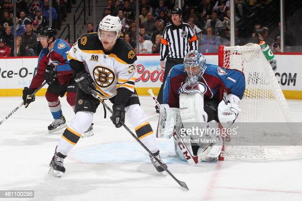 Carl Soderberg of the Boston Bruins sets up in front of goaltender Semyon Varlamov of the Colorado Avalanche at the Pepsi Center on March 21 2014 in...