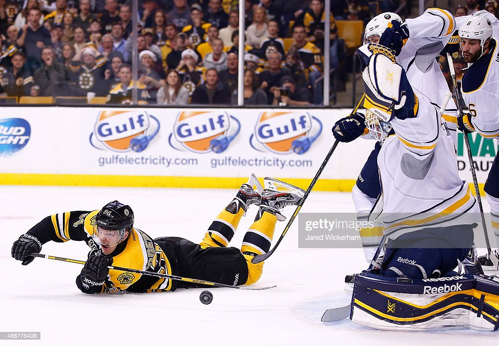 Carl Soderberg #34 of the Boston Bruins shoots from his stomach in the first period in front of <a gi-track='captionPersonalityLinkClicked' href=/galleries/search?phrase=Jhonas+Enroth&family=editorial&specificpeople=570456 ng-click='$event.stopPropagation()'>Jhonas Enroth</a> #1 of the Buffalo Sabres during the game at TD Garden on December 21, 2013 in Boston, Massachusetts.