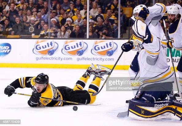 Carl Soderberg of the Boston Bruins shoots from his stomach in the first period in front of Jhonas Enroth of the Buffalo Sabres during the game at TD...