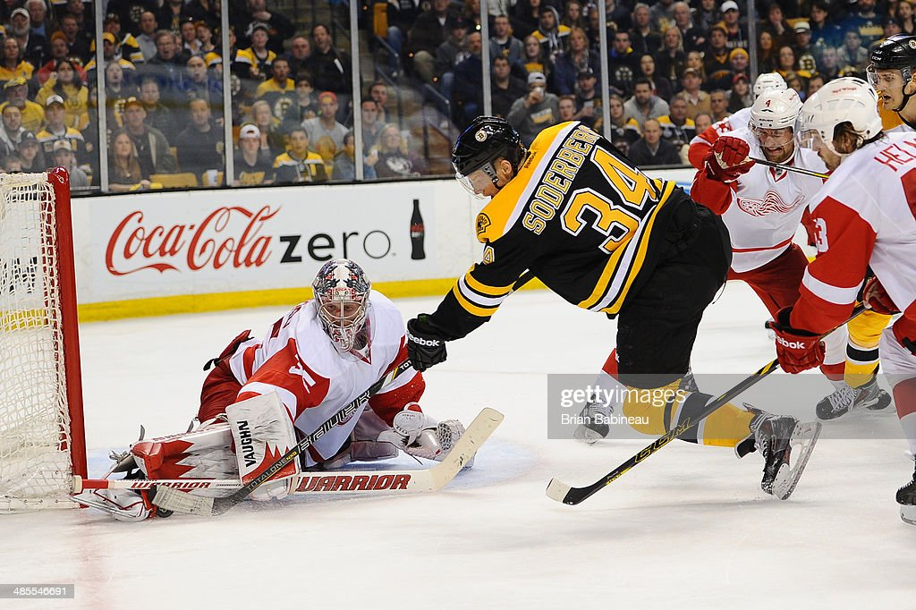 Carl Soderberg #34 of the Boston Bruins shoots the puck against <a gi-track='captionPersonalityLinkClicked' href=/galleries/search?phrase=Jimmy+Howard&family=editorial&specificpeople=2118637 ng-click='$event.stopPropagation()'>Jimmy Howard</a> #35 of the Detroit Red Wings in Game One of the First Round of the 2014 Stanley Cup Playoffs at TD Garden on April 18, 2014 in Boston, Massachusetts.
