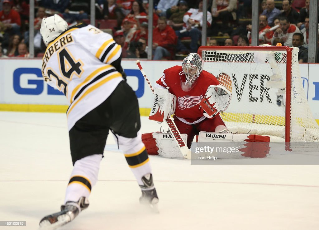 Carl Soderberg #34 of the Boston Bruins shoots the puck during the third period as <a gi-track='captionPersonalityLinkClicked' href=/galleries/search?phrase=Jimmy+Howard&family=editorial&specificpeople=2118637 ng-click='$event.stopPropagation()'>Jimmy Howard</a> #35 of the Detroit Red Wings makes the save during Game Three of the First Round of the 2014 NHL Stanley Cup Playoffs at Joe Louis Arena on April 22, 2014 in Detroit, Michigan. The Bruins defeated the Wings 3-0.