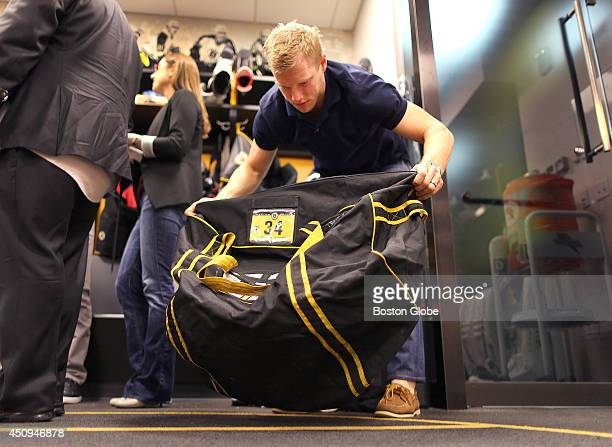 Carl Soderberg packs up his hockey gear in the Bruins locker room The Boston Bruins cleaned out their lockers in the Bruins dressing room and spoke...