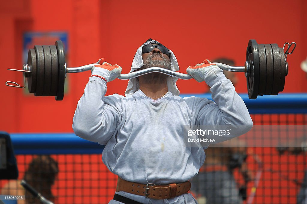 Carl Tucker lifts weights at the historic Muscle Beach workout area on Independence Day weekend at Venice Beach on July 6, 2013 in Venice, California. An estimated 16 million people visit the famous beach city annually which is celebrating 108th birthday as of July 4.