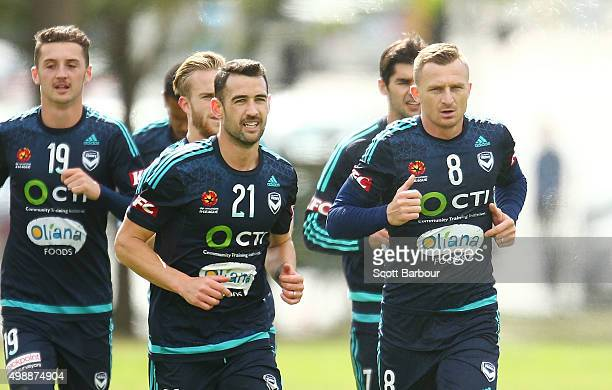 Carl Valeri and Besart Berisha of the Victory run during a Melbourne Victory ALeague training session at AAMI Park on November 27 2015 in Melbourne...