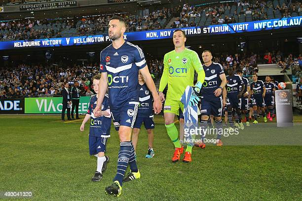 Carl Valeri and Victory players walk out during the round two ALeague match between Melbourne Victory and Melbourne City FC at Etihad Stadium on...