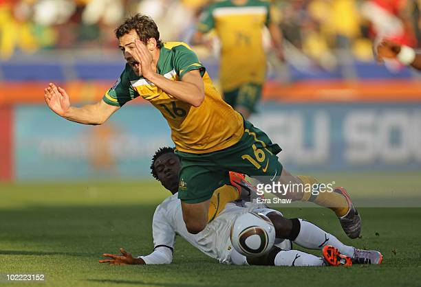 Carl Valeri of Australia falls under the challenge of Anthony Annan of Ghana during the 2010 FIFA World Cup South Africa Group D match between Ghana...