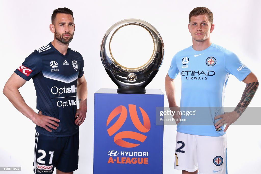 Carl Valeri of Malbourne Victory and Michael Jakobsen of Melbourne City pose during the 2017/18 A-League Season Launch at Port Melbourne SC on October 3, 2017 in Melbourne, Australia.