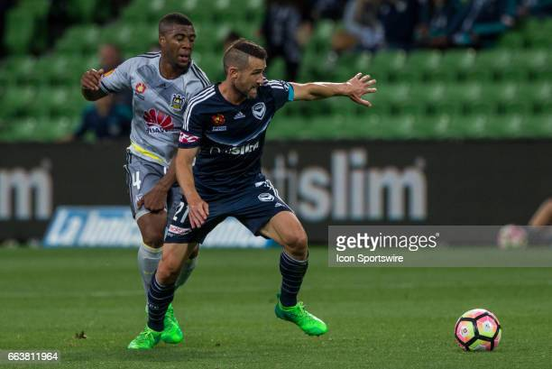 Carl Valeri of Melbourne Victory controls the ball in front of Roly Bonevacia of the Wellington Phoenix during the round 25 match of the Hyundai...