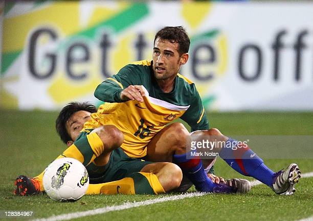 Carl Valeri of the Socceroos makes a tackle during the International Friendly match between the Australian Socceroos and Malaysia at Canberra Stadium...