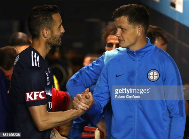 Carl Valeri of the Victory and Michael Jakobsen of the City shake hands during the round two ALeague match between Melbourne Victory and Melbourne...