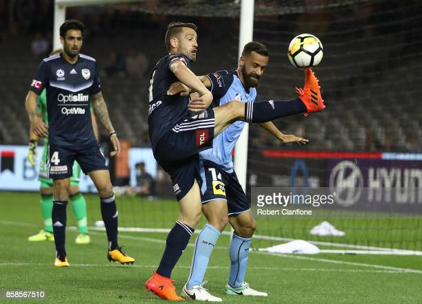 Carl Valeri of the Victory challenges Alex Brosque of Sydney FC during the round one ALeague match between the Melbourne Victory and Sydney FC at...