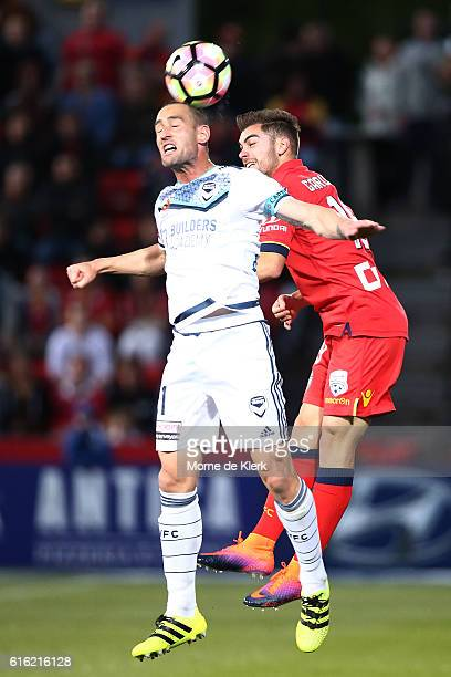Carl Valeri of the Victory competes for the ball with Benjamin Garuccio of Adelaide United during the round three ALeague match between Adelaide...