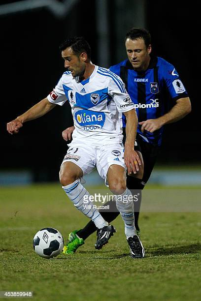 Carl Valeri of the Victory controls the ball under pressure from Todd Howarth of Bayswater City during the FFA Cup match between Bayswater City and...