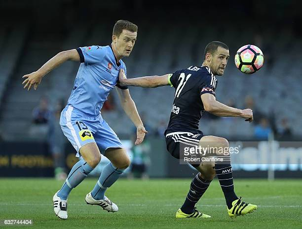 Carl Valeri of the Victory is challenged by Brandon O'Neill of Sydney FC during the round 17 ALeague match between the Melbourne Victory and Sydney...