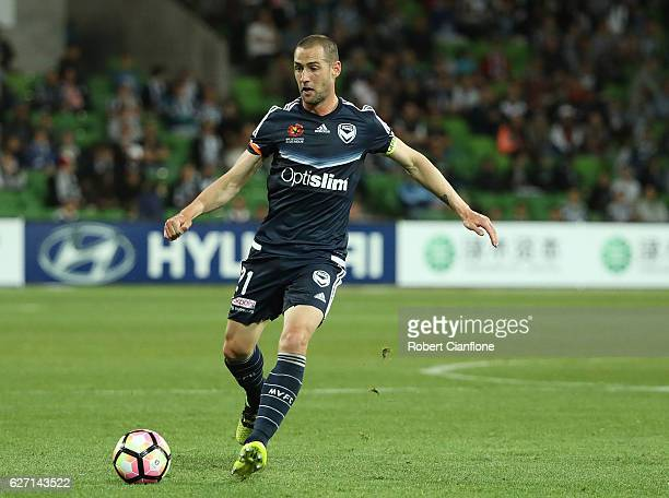 Carl Valeri of the Victory passes the ball during the round nine ALeague match between Melbourne Victory and Perth Glory at AAMI Park on December 2...