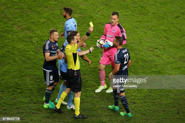 Carl Valeri of the Victory receives a yellow card during the 2017 ALeague Grand Final match between Sydney FC and the Melbourne Victory at Allianz...