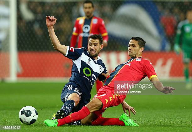 Carl Valeri of Victory and Osama Malik of Adelaide contest the ball during the FFA Cup Quarter Final match between the Melbourne Victory and Adelaide...