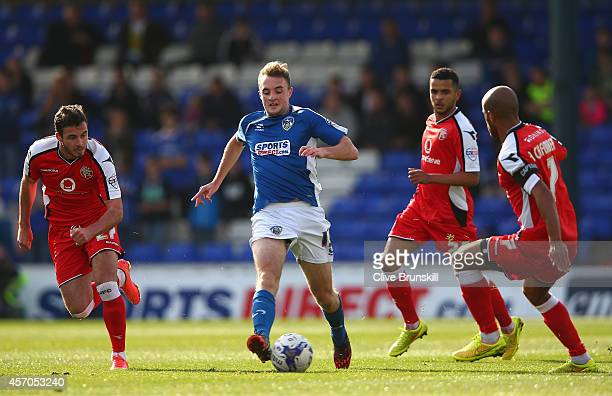 Carl Winchester of Oldham Athletic attempts to move away from Adam Chambers of Walsall during the Sky Bet League One match between Oldham Athletic...